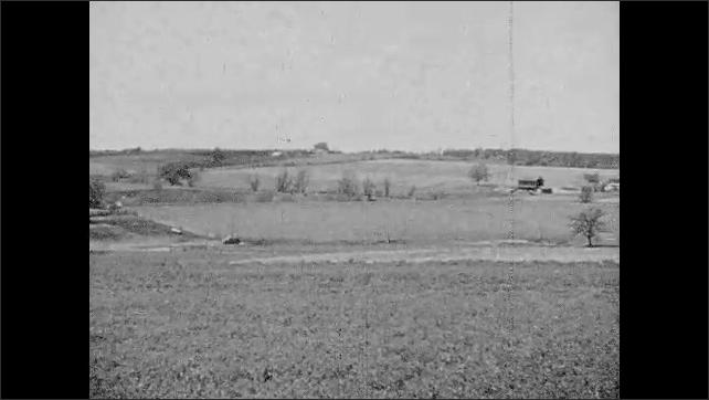 1940s: Farm.  Fields.  Smoke flows from boat wreckage.