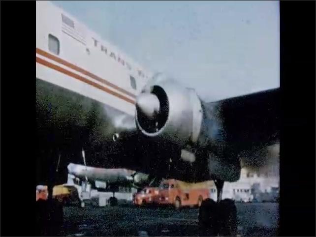 CALIFORNIA 1950s: man sits next to stranger on plane. Plane starts engines.