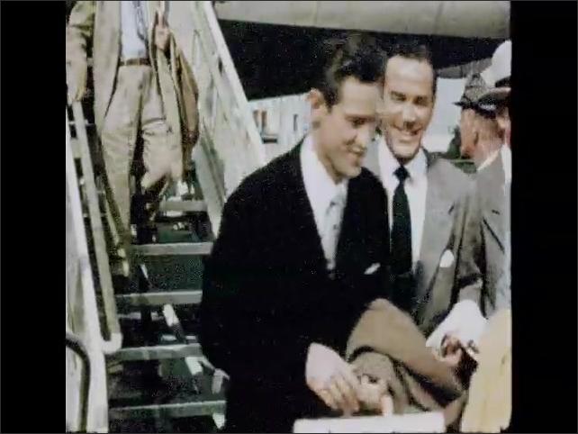 CALIFORNIA 1950s: man talks to honeymooners by plane. Passengers leave airport