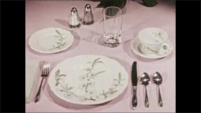 1960s: Dishware set laid out for one person at dinning table. Dishware set changes into seven different types in same setting positions on table.