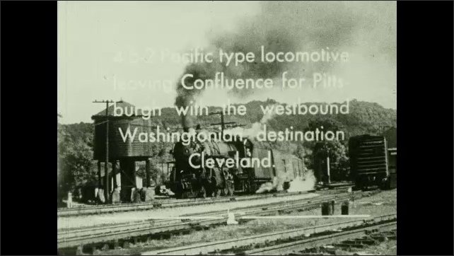 1950s: UNITED STATES: photographs from the Buffalo Express from the Pittsburgh-Buffalo. Train sets off. Smoke from train. line.