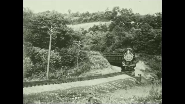 1950s: UNITED STATES: southbound Buffalo Express near Craigsville, Pa. Title. Front view of train approaching bend in tracks