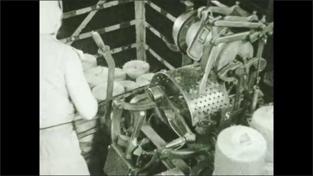 1930s: Woman loads balls of twine into cover machine. Machine wraps up balls.