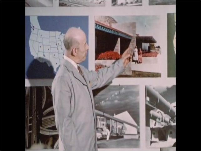 1950s: Man in coveralls pours bags of cement into mixer. Man with lab coat stands before display wall and speaks. Man points to picture of home and speaks.