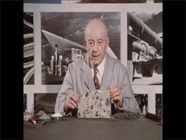 1950s: Needle moves along pressure gauge. Concrete pillar explodes under pressure. Hand holds concrete shard next to exploded pillar. Man in lab coat speaks. Man displays concrete slab and speaks.