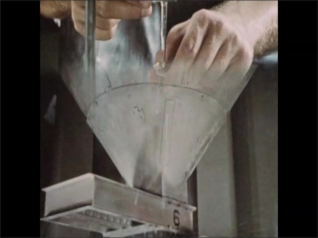 1950s: Hands spin liquid in beaker until it turns pink. Large industrial grinder.