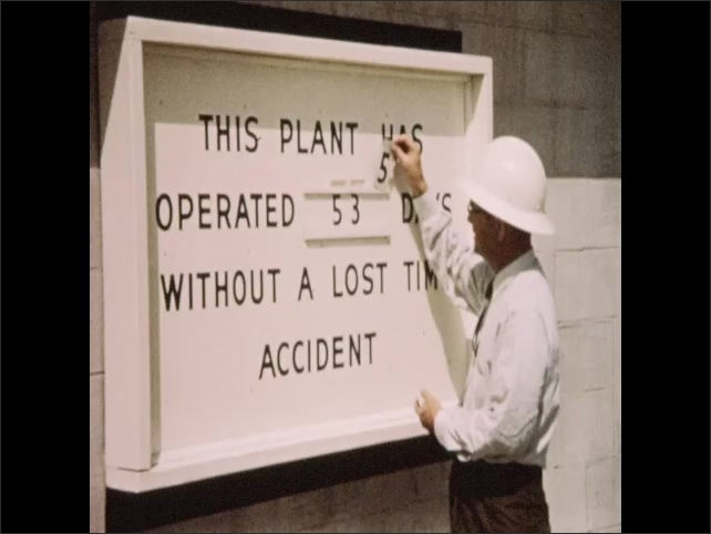 1950s: Sign outside of cement facility. Men walk outside of cement facility. Man changes numbers on safety sign. Cement research and development facility. Man adjusts magnifying device in laboratory.