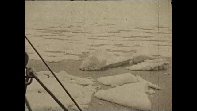 1930s: Boat goes through arctic, passed sheets of ice.