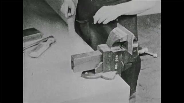 1940s: UNITED STATES: top side of filing process. Single cut file. Spacing between teeth on file. Close up of teeth.