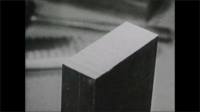 1940s: UNITED STATES: close up of teeth spacing on hand file. Operator tightens clamp on steel. Operator squares surface of metal.
