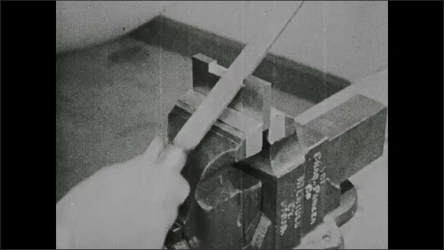 1940s: UNITED STATES: man files surface with new file. Worker files ring with double cut file.