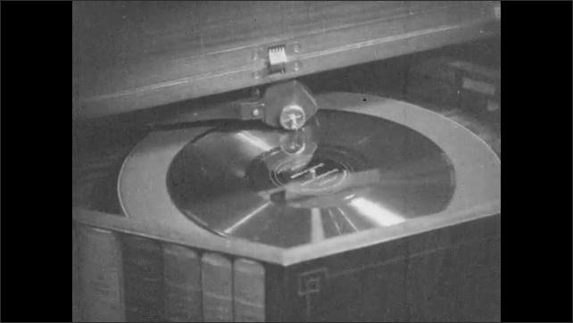 1930s: Record in record player.