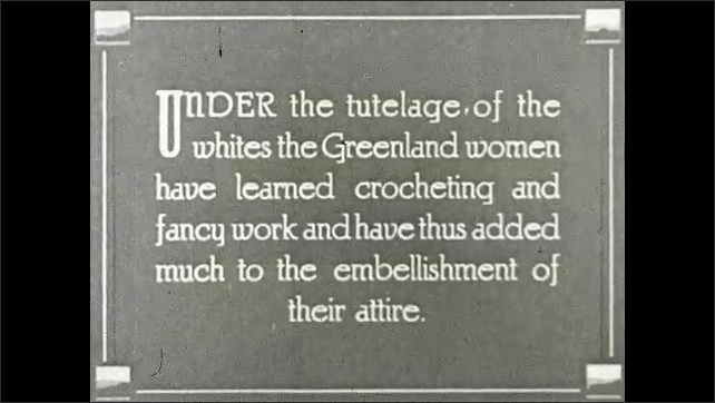 1930s: GREENLAND: crocheting on Eskimo clothing. Close up of traditional clothing. European influence on clothing
