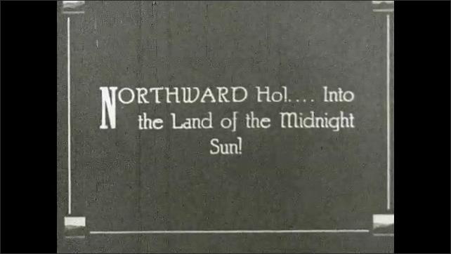 1930s: GREENLAND: men sit on boat. Midnight sun. Man in kayak.