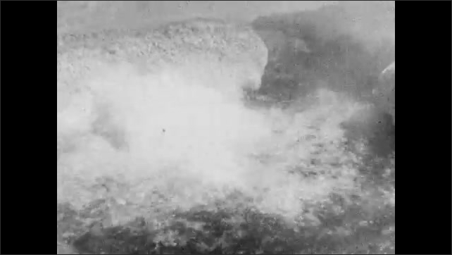 1940s: water flows around muddy pond near source. hot liquid bubbles up near rocks in geyser. steam and mist shoot up into the air as a fountain in park.