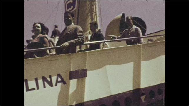 1940s: People walk down plank of docked boat to shore. Crowd of people circled around people dancing.