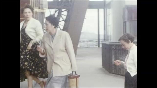 1950s: Pond. Women walk through revolving door, man follows.