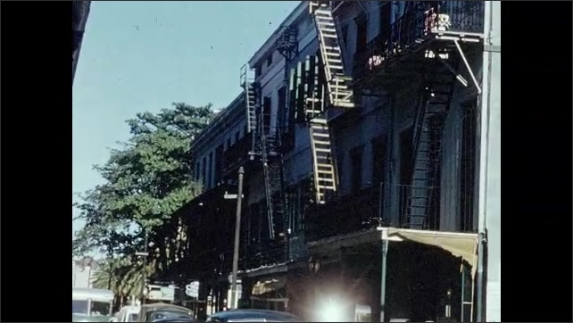 1950s: CARIBBEAN: fire escapes by building, Exterior of building. Hotel Monteleone sign.