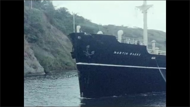 1950s: Ship travels down river.