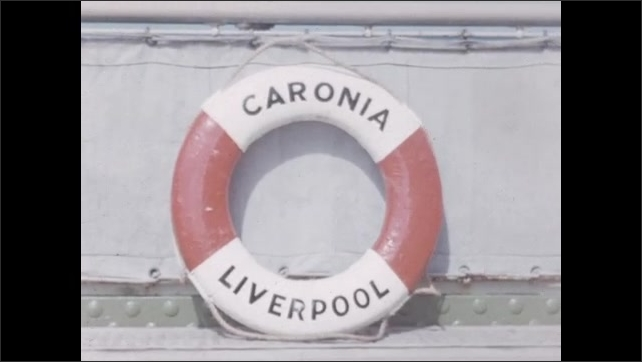 1950s: EUROPE: large ferry on ocean. Caronia Liverpool boat. Man stands by life ring.