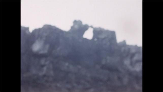 1950s: EUROPE: lady waves at camera. Icelandic landscape.