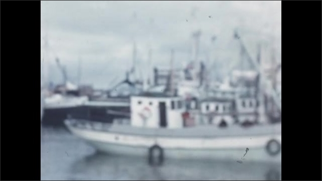 1950s: EUROPE: people on boat. Family pose for camera by boats. Holiday in Iceland
