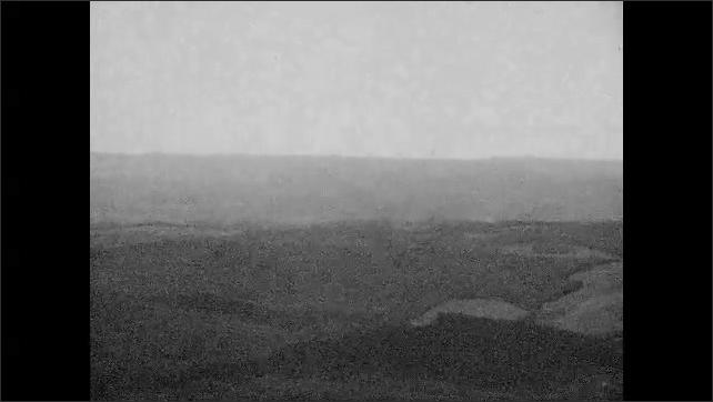 1940s: Pan across hills, scenery.