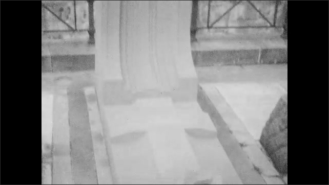 1940s: Views of headstones and monuments in cemetery.