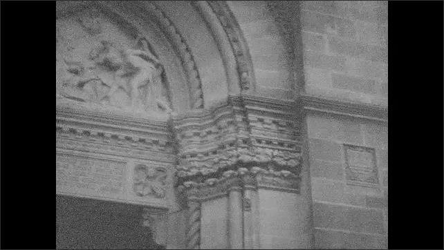 1940s: Pan across front of church, people walk down steps. Views of church doorway.