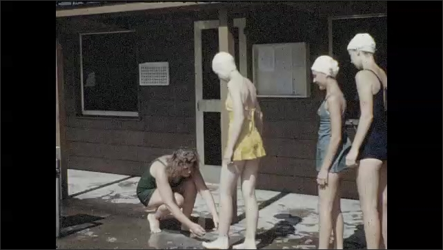 1940s: UNITED STATES: girls have fun at swimming pool. Girl dives into pool. Girls get foot inspection at pool. Lady checks feet.