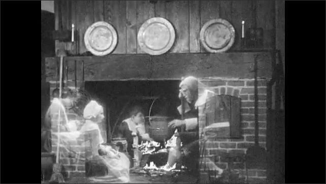 1930s: UNITED STATES: ghosts of family working by fireplace. Boy talks to man by fire in New England home.