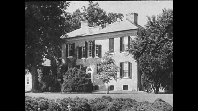1930s: UNITED STATES: view towards house and gardens by river. Georgian style home. Pigeon House. House in Virginia