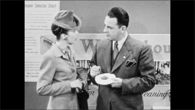 1940s: Hand with pen moves dirt and lint around filter. Woman and salesman talk. Hand holds filter with dirt and grit.