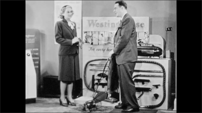 "1940s: Westinghouse salesman demonstrates ""convertible"" vacuum cleaner to customer. Salesman talks to skeptical customer, then spreads dirt on carpet."