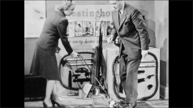 1940s: Westinghouse salesman removes vacuum bag and places filter paper between bag and vacuum apparatus. Customer uses vacuum on carpet. Salesman removes bag and shows customer dirty filter paper.