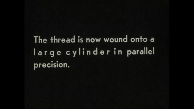 """1930s: Women feed silk threads into needles on power looms. Intertitle """"The thread is now wound onto a large cylinder in parallel precision""""."""