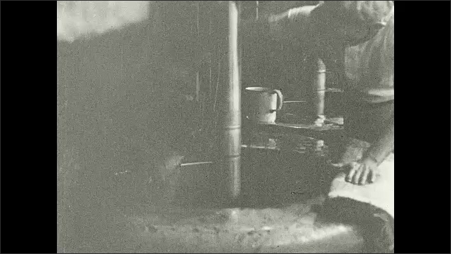 1930s: Title card. Molasses pours into circular vats, assisted by man. Inside of the vat begins spinning.