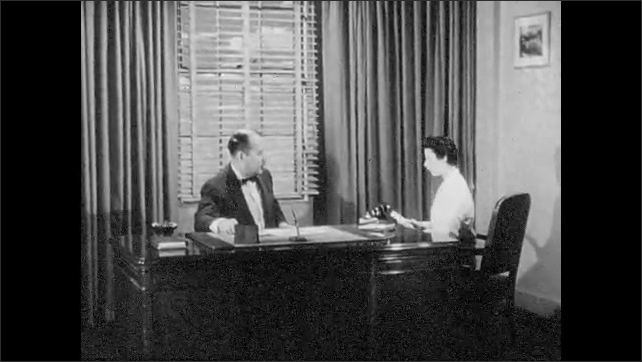 1950s: Outboard motor starts in water. executive at desk listens to secretary talk.