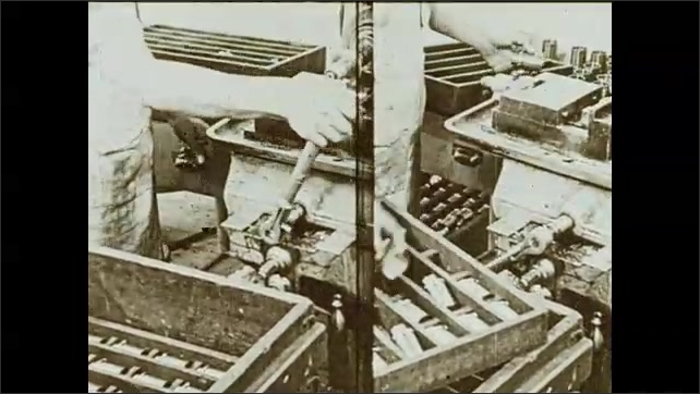 1930s: Workers in a factory. Man operates industrial machine. Split screen of two men who operate machine and put goods into container. Man stands next to machine. Chimney with smoke.