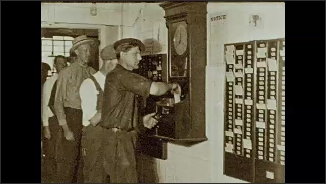 1930s: Factory workers punch card on time clock. Two men wash their faces, clean it with a towel and walk away. Workers punch card on time clock. Several men leave building.