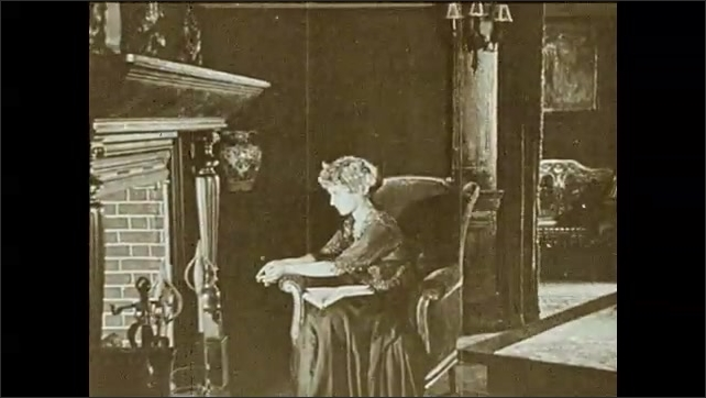 1930s: Intertitle. House with a yard, child rides a tricycle. Woman sits on armchair, a man enters the room, talks to woman, shows her a paper and sits on the armchair, child watches at the entrance.