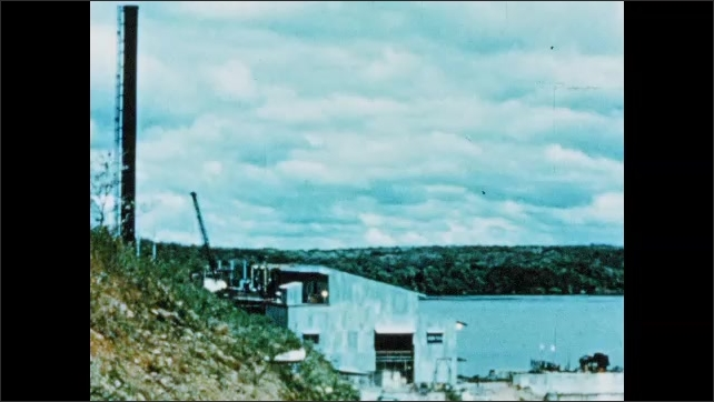 1950s: South America: ore handling facilities by Orinoco River. Electrical building and generator. Interior of power house