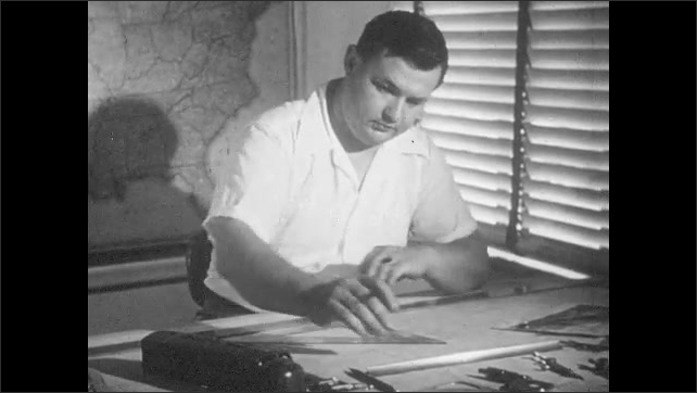 1950s: executives discuss prototypes of model trains. Designers at drawing tables study model train cars and photographs. Designers draw and use ruler. Real locomotives race down track.