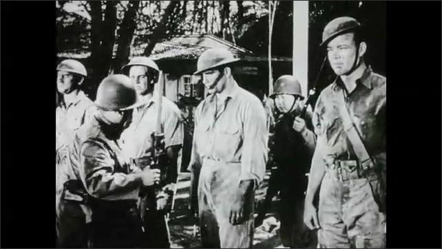 1940s: War, smoke billows, field, soldiers in helmets, man holds Rising Sun flag.  Man frisks prisoners of war, man pushes back, is attacked. Night, people gather, sit on bench outside building.