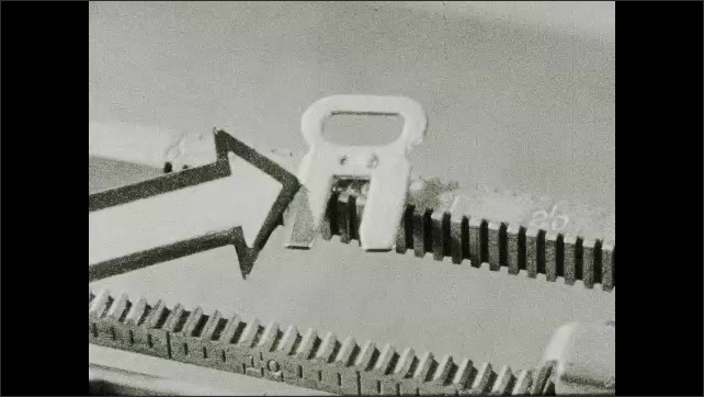 1930s: Arrow points to scale on typewriter????s tab stop. Arrow points to typewriter????s tab stop. Hand inserts the tab stop. Arrow points to tab stop on typewriter????s scale.
