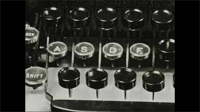 1930s: Intertitle ????he four fingers of each hand should rest on the home keys???? Stick points to letters on a typewriter????s keyboard poster. Hand over space bar. Fingers press ????SDF????keys.