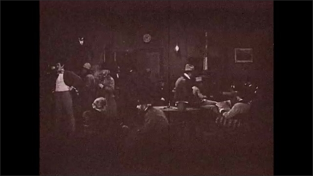 1930s: Title card. Men enter crowded lobby of inn. Men smoke and drink near table.