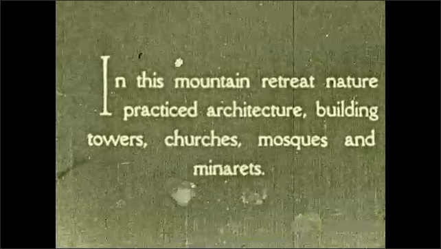 1930s: Intertitle ????n this mountain retreat nature practiced architecture, building towers, churches, mosques and minarets????