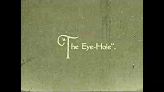 """1930s: Intertitle ????he Three Patriarchs"""". Cliffs. Intertitle ????he Eye-Hole???? Desert landscape with trees and rock formations. Round hole in the middle of a cliff with trees on the bottom."""