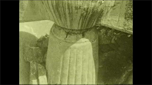 1930s: UNITED STATES: limestone inside machine. Rocks on conveyor